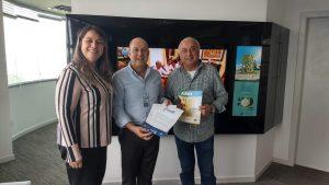 Lara Perdigão, Relações Públicas da ABIH-SC, Marcello Petrelli, presidente executivo do Grupo RIC SC e Osmar José Vailatti, Diretor-presidente da ABIH-SC.
